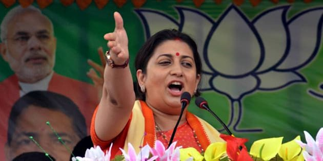 Indian Minister for Human Resource Development Smriti Irani addresses party workers during a Bharatiya Janata Party (BJP) election campaign rally ahead of state assembly elections for Assam in Karimganj on March 30, 2016. 