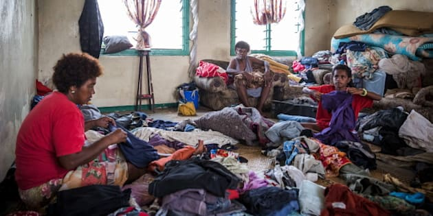Fijian 10-year-old Lusiana (R) helps her grandmother (C) and aunt (L) sort through clothes in Rakiraki district in Fiji's Ra Province, February 24 2016, after homes were damaged and destroyed by Cyclone Winston in this handout picture supplied by UNICEF.      REUTERS/UNICEF-Sokhin/Handout via Reuters       ATTENTION EDITORS - THIS PICTURE WAS PROVIDED BY A THIRD PARTY. REUTERS IS UNABLE TO INDEPENDENTLY VERIFY THE AUTHENTICITY, CONTENT, LOCATION OR DATE OF THIS IMAGE. FOR EDITORIAL USE ONLY. NOT FOR SALE FOR MARKETING OR ADVERTISING CAMPAIGNS. FOR EDITORIAL USE ONLY. NO RESALES. NO ARCHIVE. THIS PICTURE IS DISTRIBUTED EXACTLY AS RECEIVED BY REUTERS, AS A SERVICE TO CLIENTS.