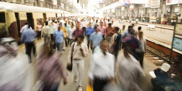 Commuting travelers during rush hour in Mumbai, India