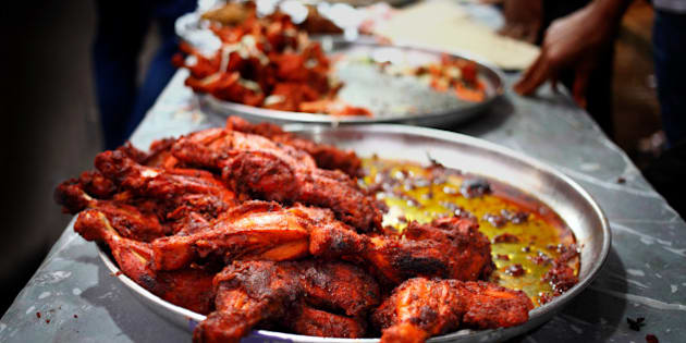 Display of chicken tandoor at food stalls outside Jamiatul Qureshi Masjid Camp, Pune(India). During ramadan there will be food stalls selling variety of snacks to break the ramadan fasting. It becomes compulsory for Muslims to start fasting during ramadan when they reach puberty.