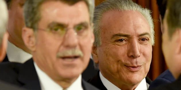 Acting Brazilian President Michel Temer (R) and Romero Juca, a former minister of planning who left the government due to allegations of involvement in attempts to block investigations of corruption at Petrobras, during a meeting held with allied party leaders in Congress to present Temer's economic measures at the Planalto Palace in Brasilia on May 24, 2016. / AFP / EVARISTO SA        (Photo credit should read EVARISTO SA/AFP/Getty Images)