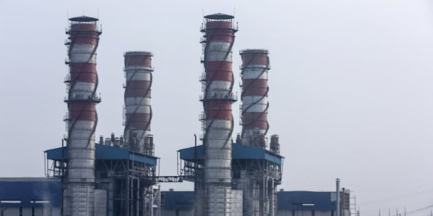The 1500 Megawatt Combined Cycle Power Station Bawana operated by Pragati Power Corp. (PPCL) stands in Bawana, Delhi, India on Tuesday, May 3, 2016. About 25 kilometers (16 miles) northwest of Prime Minister Narendra Modi's office in New Delhi, a $780 million gas-fired electricity plant that could reduce the choking pollution in India's capital is operating at a fraction of its potential. The facility ran at about a sixth of capacity on Monday, while a much older, belching coal plant some 15 kilometers southeast of central New Delhi provided the biggest share of the city's power generation. Photographer: Udit Kulshrestha/Bloomberg via Getty Images