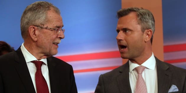 Alexander Van der Bellen, candidate of the Austrian Greens talks with Norbert Hofer, right, of Austria's Freedom Party, FPOE, during the release of the first election results of the Austria presidential elections in Vienna, Austria, Sunday, April 24, 2016. (AP Photo/Ronald Zak)