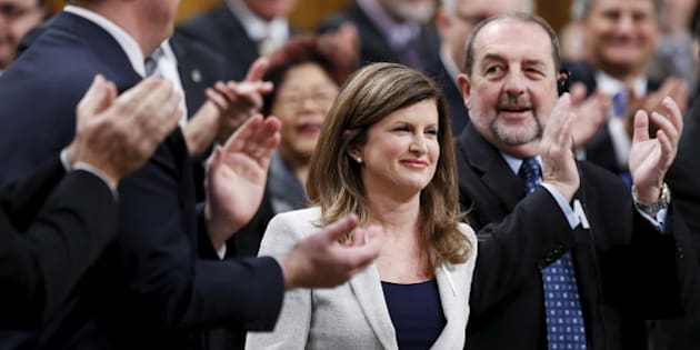 Interim Conservative Leader Rona Ambrose (C) receives a standing ovation from her caucus during a debate on the Speech from the Throne in the House of Commons on Parliament Hill in Ottawa, Canada, December 7, 2015. REUTERS/Chris Wattie