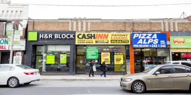 TORONTO, ON - FEBRUARY 27  - A payday loan store near the intersection of Weston Road and Lawrence avenue west.    ACORN Toronto is hosting a forum to discuss its campaign to get the City of Toronto to create a minimum distance separation bylaw between payday loans outlets to limit the number that can exist in certain areas.        (Carlos Osorio/Toronto Star via Getty Images)