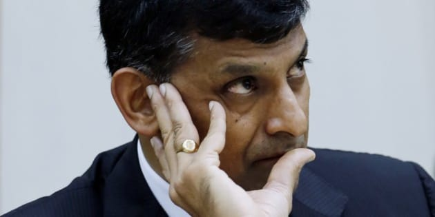 Reserve Bank of India Governor Raghuram Rajan takes a question from a journalist during a press conference in Mumbai, India, Tuesday, Aug. 5, 2014. India's central bank says it sees signs of recovery in Asia's third-largest economy even though the monsoon season, which is crucial for agriculture, had a weak start. (AP Photo/Rajanish Kakade)