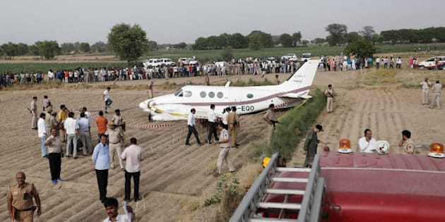 Security personnel secure the site where an air-ambulance, carrying seven passengers, crash landed after losing both its engines, according to local media, in New Delhi, India May 24, 2016. REUTERS/Anindito Mukherjee