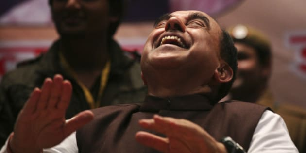 Subramanian Swamy, an opposition politician who brought the petition to revoke the telecoms licences issued in 2008, laughs during a seminar against corruption in New Delhi February 4, 2012. India's beleaguered government won some rare relief on Saturday when a court threw out a corruption case against one its top ministers ahead of crucial state elections next week. The court dismissed a petition accusing Home Minister Palaniappan Chidambaram of signing off on the sale of telecoms licenses at below-market prices that may have cost the government up to $36 billion in lost revenues. REUTERS/Parivartan Sharma (INDIA - Tags: POLITICS BUSINESS TELECOMS)