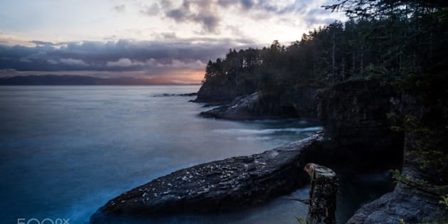 The view to the north of the overlook, just as the sun rises in the east, lighting up Vancouver Island.