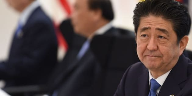Japan's Prime Minister Shinzo Abe takes part in a dialogue with world leaders at the G7 Summit in Shima in Mie prefecture on May 27, 2016. A British secession from the European Union in next month's referendum could have disastrous economic consequences, G7 leaders warned on May 27 at the close of the summit in Japan. / AFP / STEPHANE DE SAKUTIN        (Photo credit should read STEPHANE DE SAKUTIN/AFP/Getty Images)
