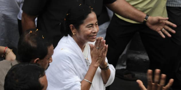 Trinamul Congress leader Mamata Banerjee greets people with folded hands as she walks in a road show ahead of the West Bengal state Assembly elections, in Kolkata, India, Sunday, April 24, 2016. The six-phased poll started on April 4 and is scheduled to end on May 5. Results are expected on May 19. (AP Photo/ Bikas Das)