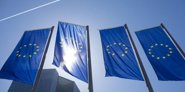 The stars of the European Union (EU) sit on banners flying outside the European Central Bank (ECB) headquarters ahead of ECB President Mario Draghi's news conference to announce the central bank's interest rate decision in Frankfurt, Germany, on Thursday, April 21, 2016. With no new measures expected at Thursdays monetary-policy meeting, the ECB president may use his press conference to point to signs that negative rates, free bank loans and a 1.7 trillion-euro ($1.9 trillion) bond-buying program should be enough to revive euro-area inflation. Photographer: Jasper Juinen/Bloomberg via Getty Images