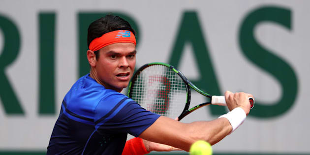 PARIS, FRANCE - MAY 27:  Milos Raonic of Canada hits a backhand during the Men's Singles third round match against Andrej Martin of Slovakia on day six of the 2016 French Open at Roland Garros on May 27, 2016 in Paris, France.  (Photo by Julian Finney/Getty Images)