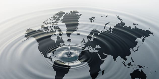 Rippling water over map of globe
