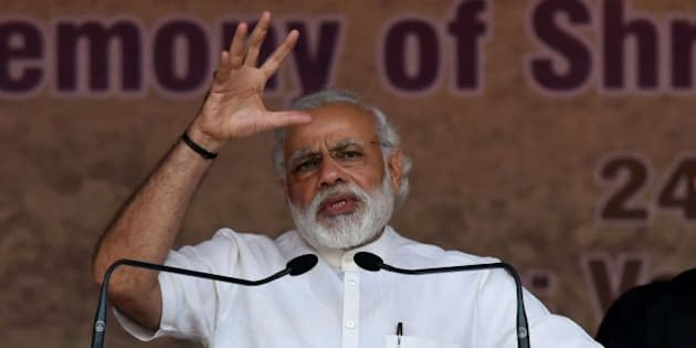 India's Prime Minister Narendra Modi gestures as he addresses the audience during the swearing-in ceremony of Sarbananda Sonowal as Chief Minister of the north-eastern state of Assam in Guwahati on May 24, 2016.  India's ruling Bharatiya Janata Party claimed victory in Assam elections, marking the first time the Hindu nationalist party has won control of a state in the India's restive northeast. / AFP / Biju BORO        (Photo credit should read BIJU BORO/AFP/Getty Images)