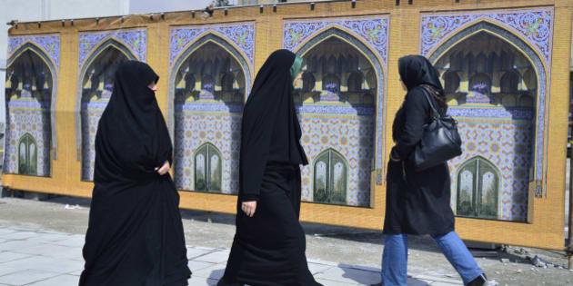 Women in the street, dressed in chador,Tehran.
