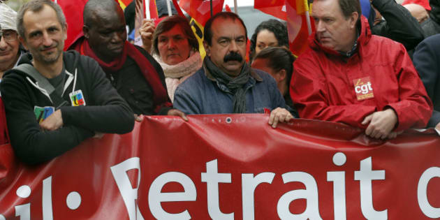 CGT trade union leader Philippe Martinez, center, attends a demonstration against proposed changes to France's work week and layoff practices, in Paris, Saturday, April 9, 2016. Protesters across France are marching to voice their anger at labor reforms being championed by the country's Socialist government. (AP Photo/Christophe Ena)