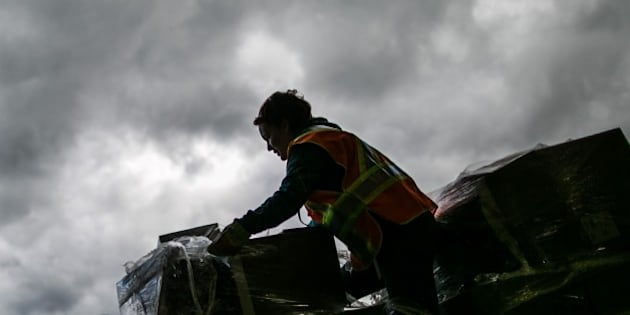 ALBERTA, CANADA - MAY 9 , 2016. A Volunteer loads donated items near Bold community center in Lac la Biche, south of Fort McMurray, Alberta, Canada on 9 May 2016. Wildfire erupted on 3 May consuming 200 thousand hictars and destroying 90% of houses in Fort McMurray city. 88 thousand people were evacuated from northern Alberta. (Photo by Amru Salahuddien/Anadolu Agency/Getty Images)