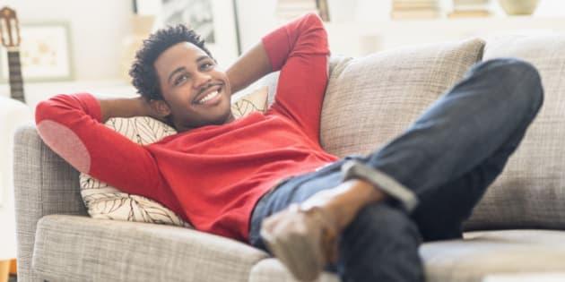 Man lying on sofa and smiling