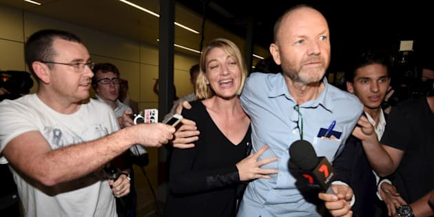 Australian 60 Minutes journalist Tara Brown (C) and 60 Minutes producer Stephen Rice arrive at Sydney International Airport, April 21, 2016. REUTERS/Dean Lewins/AAP ATTENTION EDITORS - THIS IMAGE WAS PROVIDED BY A THIRD PARTY. EDITORIAL USE ONLY. AUSTRALIA OUT. NEW ZEALAND OUT.  NO RESALES. NO ARCHIVE.