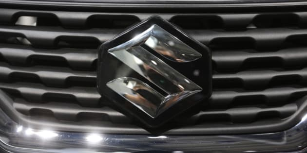 The Suzuki badge sits on the grill of a Suzuki Baleno automobile, produced by Suzuki Motor Corp., at the IAA Frankfurt Motor Show in Frankfurt, Germany, on Wednesday, Sept. 16, 2015. The Frankfurt International Motor Show starts on Thursday, and nearly one million visitors are expected to view the latest must-have vehicles and motoring technology from over 1,000 exhibitors in a space equivalent to 33 soccer fields. Photographer: Chris Ratcliffe/Bloomberg via Getty Images
