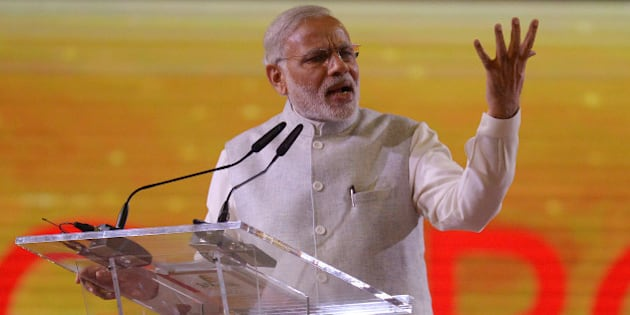 Indian Prime Minister Narendra Modi delivers a public speech to a crowd of mostly Indian nationals at the Singapore Expo, Tuesday, Nov. 24, 2015 in Singapore. Modi is on a two-day official visit to the city-state. (AP Photo/Joseph Nair)