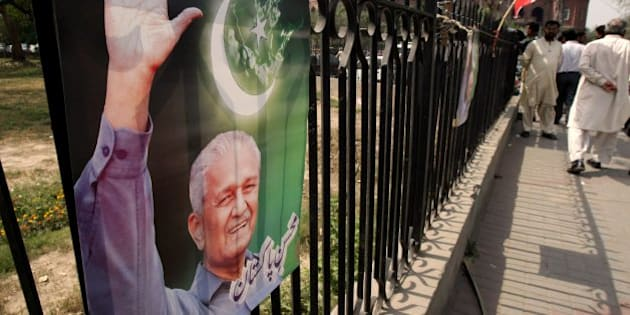 A poster of Pakistani disgraced nuclear scientist A.Q. Khan, also known as Abdul Qadeer Khan, is seen on a grill hanged by his supporter in Lahore Pakistan on Monday, March 29, 2010. A Pakistan court has maintained restrictions on Khan who allegedly leaked atomic weapons secrets to Iran, North Korea and Libya. The court ruled Khan was not allowed to talk about nuclear weapons technology and must inform security agencies before he leaves his house so they can accompany him where ever he goes, Khan's lawyer said. (AP Photo/K.M. Chaudary)