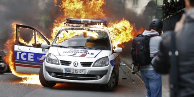 voiture de police brûlée: un cinquième suspect, un américain de 27