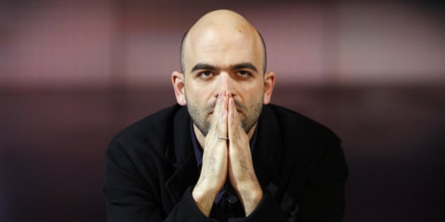 "Italian writer Roberto Saviano, author of ""Gomorra"", looks on during Italian television program ""Che tempo che fa"" in Milan March 25, 2009. Saviano is a symbol of the fight against the mafia since his best-selling book ""Gomorra"" exposed how the mob dominates life around Naples. The 29-year old has received death threats and lives under police escort. REUTERS/Alessandro Garofalo (ITALY SOCIETY CONFLICT)"