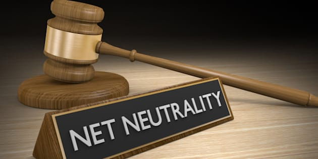 Data equality concept of a wooden court gavel next to a sign that says net neutrality,