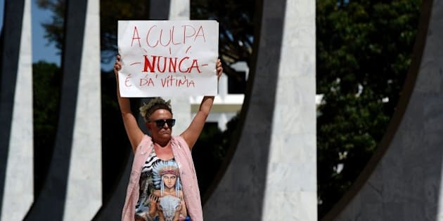 Brazilians protest outside the Supreme Court in Brasilia on May 29, 2016, against the recent gang-rape of a 16-year-old girl.