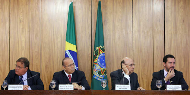 Brazil's Minister Chief of the Secretary Office of Government Geddel Vieira Lima, Chief of Staff Minister Eliseu Padilha, Brazil's Finance Minister Henrique Meirelles and Dyogo Oliveira, interim Minister of Planning are seen during a news conference after a meeting of the presentation of economic measures, at the Planalto Palace in Brasilia, Brazil, May 24, 2016. REUTERS/Adriano Machado