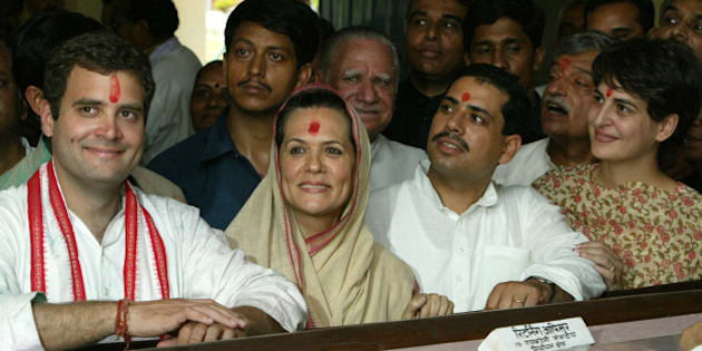 Sonia Gandhi (2nd L), president of India's main opposition Congress party, smiles after she filed her nomination papers as her son Rahul Gandhi (L), son-in-law Robert Vadra (2nd R), daughter Priyanka Vadra (R) and party supporters look on in Rae Bareli, in the northern Indian state of Uttar Pradesh, April 6, 2004. Gandhi's are contesting two seats in the state. The national elections in India, in which more than 675 million people are eligible to vote, will be held in five phases between April 20 to May 10. REUTERS/Kamal Kishore  KK/AH/TW