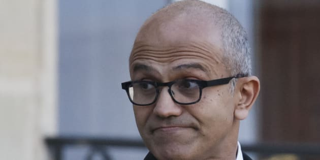 Microsoft CEO Satya Nadella looks back to the media as he leaves the Elysee Palace after a meeting with France's President Francois Hollande in Paris, France, Monday, Nov. 9, 2015. Satya Nadella will meet students later to discuss economic opportunities in the digital age. (AP Photo/Michel Euler)