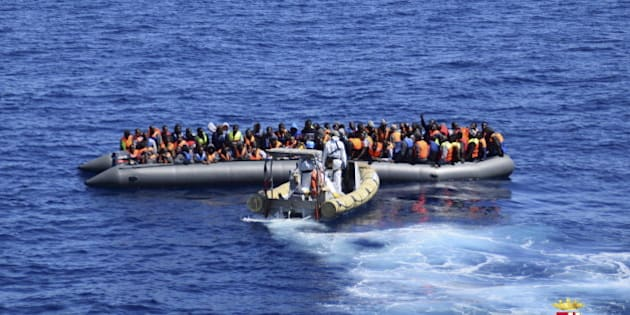 Migrants sit in their boat during a rescue operation by Italian Navy vessels off the coast of Sicily in this April 11, 2016 handout picture provided by Italy's Marina Militare. REUTERS/Marina Militare/Handout via Reuters ATTENTION EDITORS - THIS PICTURE WAS PROVIDED BY A THIRD PARTY. REUTERS IS UNABLE TO INDEPENDENTLY VERIFY THE AUTHENTICITY, CONTENT, LOCATION OR DATE OF THIS IMAGE. FOR EDITORIAL USE ONLY. NOT FOR SALE FOR MARKETING OR ADVERTISING CAMPAIGNS. THIS PICTURE IS DISTRIBUTED EXACTLY AS RECEIVED BY REUTERS, AS A SERVICE TO CLIENTS.      TPX IMAGES OF THE DAY