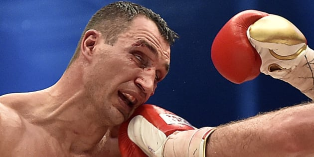 Ukraine's Wladimir Klitschko, is hit by Britain's Tyson Fury in a world heavyweight title fight for Klitschko's WBA, IBF, WBO and IBO belts in the Esprit Arena in Duesseldorf, western Germany, Sunday, Nov. 29, 2015. Klitschko lost his title. (AP Photo/Martin Meissner)