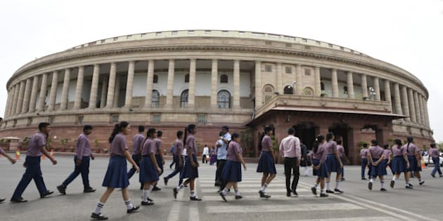 NEW DELHI, INDIA - MAY 3: School students arrive at Parliament House during the Parliament Session on May 3, 2016 in New Delhi, India. With the BJP mounting an offensive against Congress vice-president on the AgustaWestland VVIP chopper bribery case, Rahul Gandhi on Wednesday said he is happy to be targeted. (Photo by Sonu Mehta/Hindustan Times via Getty Images)