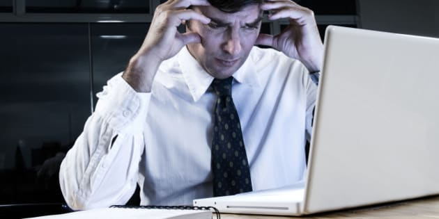 Stressed business man working on computer