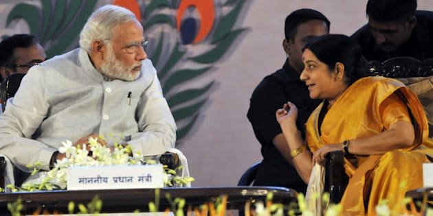 BHOPAL, INDIA - SEPTEMBER 10: Prime Minister Narendra Modi having a word with External Affairs Minister Sushma Swaraj during the inauguration of the 10th World Hindi Conference on September 10, 2015 in Bhopal, India. Around 2,000 participants from India and 27 countries are expected to attend the 10th edition of the Vishwa Hindi Sammelan, being held on September 10-12 in Bhopal. (Photo by Praveen Bajpai/Hindustan Times via Getty Images)