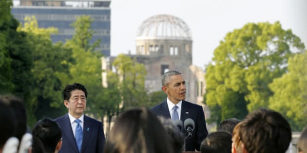 U.S. President Barack Obama gives a speech next to Japanese Prime Minister Shinzo Abe at Hiroshima Peace Memorial Park in Hiroshima, western, Japan, Friday, May 27, 2016. Obama on Friday became the first sitting U.S. president to visit the site of the world's first atomic bomb attack, bringing global attention both to survivors and to his unfulfilled vision of a world without nuclear weapons. The Atomic Bomb Dome is seen in the background. (Kimimasa Mayama/Pool Photo via AP)