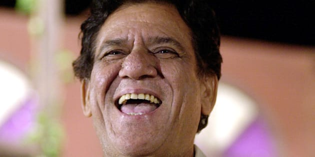 Bollywood actor Om Puri laughs after being felicitated at a function to mark the 57th anniversary of Indias Independence in Bombay, India, Sunday, Aug.15, 2004. Puri was awarded Order of the British Empire by Queen Elizabeth II for his outstanding services to the British film industry earlier this year. (AP Photo/Rajesh Nirgude)