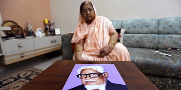 Zakia Jafri shows a photograph of her late husband Ehsan Jafri, a lawmaker for the Congress party which now sits in opposition, who was hacked to death by a Hindu mob in riots, inside her son's house in Surat, India, September 15, 2015. Jafri, a frail 76-year-old, has begun what may be the last legal battle to pin blame on Indian Prime Minister Narendra Modi for deadly riots that shook the state of Gujarat when he was chief minister, and claimed her husband's life. Picture taken September 15, 2015. REUTERS/Amit Dave      TPX IMAGES OF THE DAY