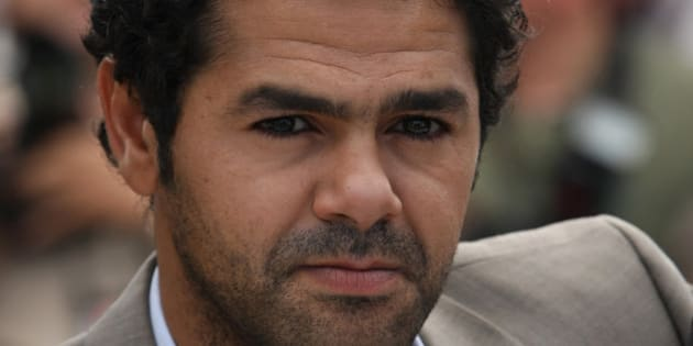 """Actor Jamel Debbouze poses during a photo call for the film """"Outside of the Law"""", at the 63rd international film festival, in Cannes, southern France, Friday, May 21, 2010. (AP Photo/Lionel Cironneau)"""