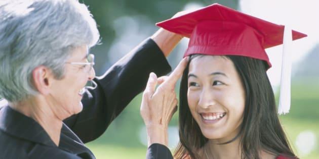 Female Graduate with Teacher