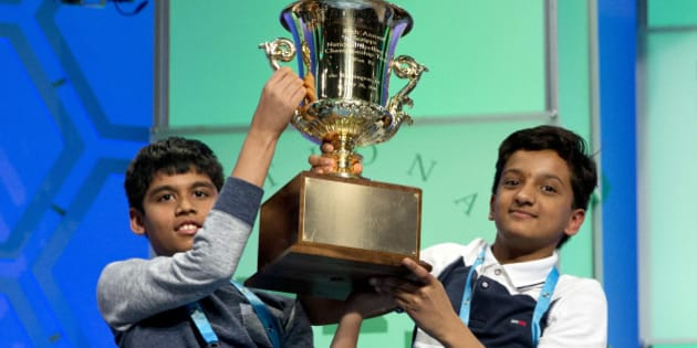 Nihar Janga, 11, of Austin, Texas, and Jairam Hathwar, 13, of Painted Post, N.Y., hold up the trophy after being named co-champions at the 2016 National Spelling Bee, in National Harbor, Md., on Thursday, May 26, 2016. (AP Photo/Jacquelyn Martin)