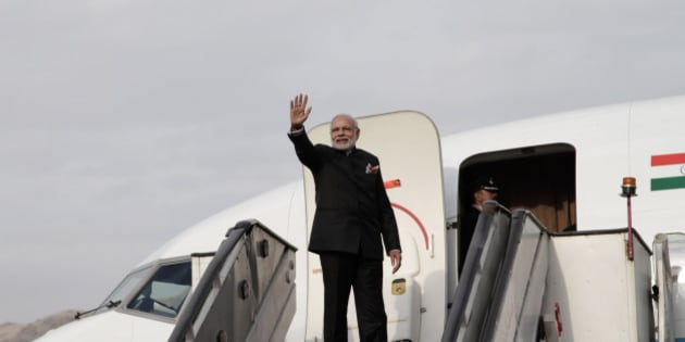 Indian Prime Minister Narendra Modi gives a goodbye as he boards his plane at Kabul International Airport in Kabul, Afghanistan, Friday, Dec. 25, 2015, India donated four Mi-25 attack helicopters to Afghanistan Air Force. (AP Photo/Rahmat Gul)