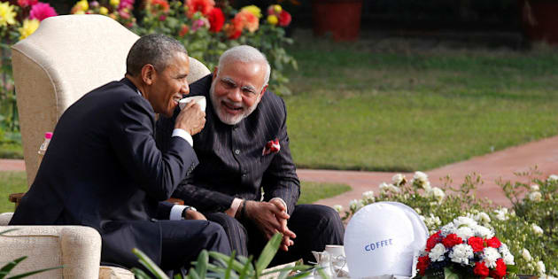 U.S. President Barack Obama and India's Prime Minister Narendra Modi (R) talk as they have coffee and tea together in the gardens of Hyderabad House in New Delhi January 25, 2015.   REUTERS/Jim Bourg/File Photo