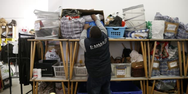 An employee selects second-hand items at the Emmaus Defi Bric a Brac show room in Paris November 16, 2012. The place is managed by French charity association Emmaus to fight social exclusion, employees collect furniture, ornaments, textiles and electrical devices donated by people and resell them at reasonable prices. Picture taken November 16, 2012. REUTERS/Benoit Tessier  (FRANCE - Tags: SOCIETY)