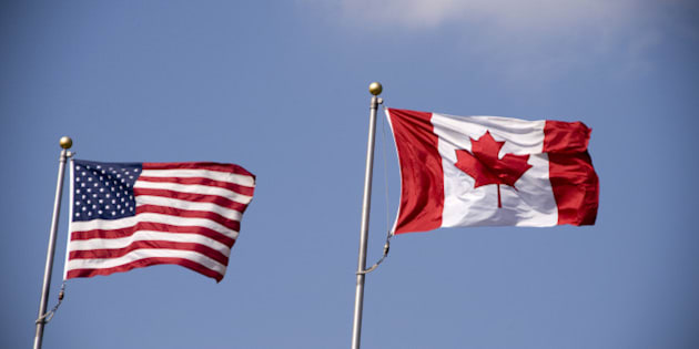 American and Canadian flag flying side by side.