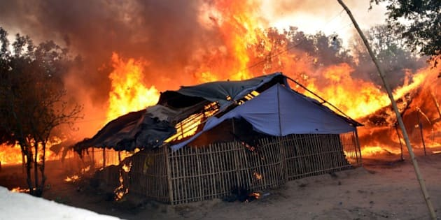 MATHURA, INDIA - JUNE 2: A fire break out after clashes between police and encroachers, believed to be of Azad Bharat Vidhik Vaicharik Kranti Satyagrahi, who were being evicted from Jawaharbagh on June 2, 2016 in Mathura, India. 21 people including two senior police officers died in violence that erupted during a police drive to evict about 3,000 people who had encroached into the Jawahar Bagh park. The squatters belonged to Azad Bharat Vidhik Vaicharik Kranti Satyagrahi group and claimed to be true followers of Netaji Subhash Chandra Bose have illegally occupied public land from last two years. A cache of arms and several spent bullets of AK-47 assault rifles were seized by police from the site of the deadly clashes. (Photo by Anant Ram/Hindustan Times via Getty Images)